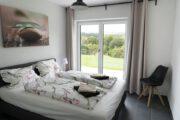 Slaapkamer met uitzicht op de natuur